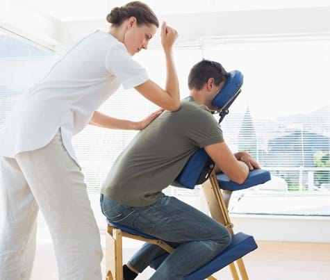 Man receiving massage as a corporate benefit